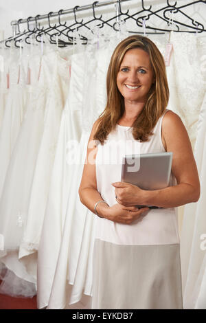 Portrait Of Female Bridal Store Owner With Digital Tablet - Stock Photo