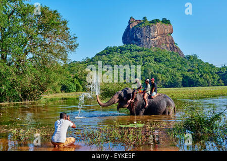 Sri Lanka, Ceylon, North Central Province, Sigiriya Lion Rock fortress, UNESCO world heritage site, tourists on - Stock Photo
