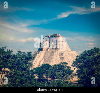 Vintage retro effect filtered hipster style image of ancient mayan pyramid Pyramid of the Magician in Uxmal, Merida, - Stock Photo