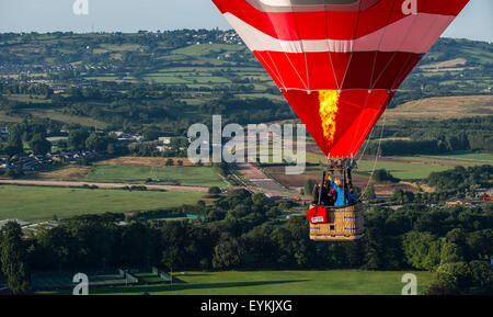 Bristol, UK. 31st July, 2015. Hot air balloons take to the skies over Bristol ahead of the 37th International Balloon Fiesta.