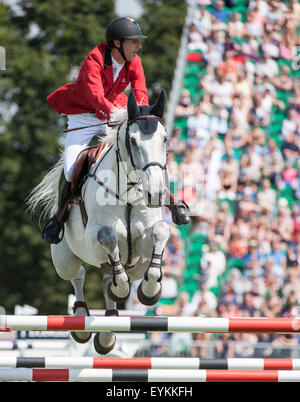 Hickstead,  UK. 31st July, 2015. The Longines Royal International Horse Show. Pieter Devos [BEL] riding DYLANO in - Stock Photo