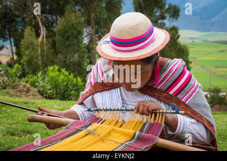 Quechua woman weaving cloth in Misminay Village, Sacred Valley, Peru. - Stock Photo