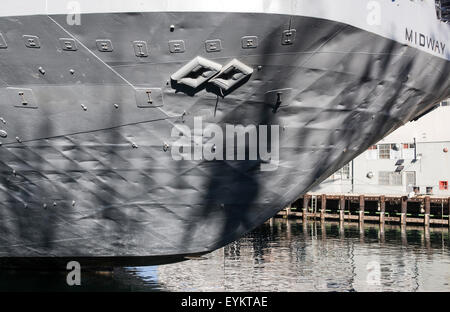 USS Midway, a decommissioned aircraft carrier that now serves as a museum, seen berthed at the waterfront in San - Stock Photo
