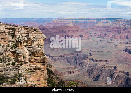 Tourists at an overlook at the Grand Canyon. - Stock Photo