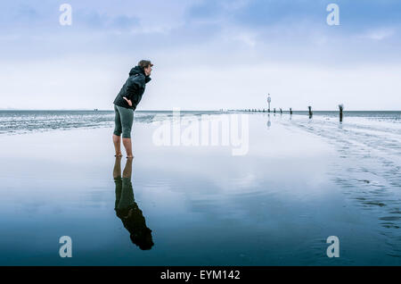 Germany, low things, new plant, Cuxhaven, wadden sea, mud flats, woman, - Stock Photo