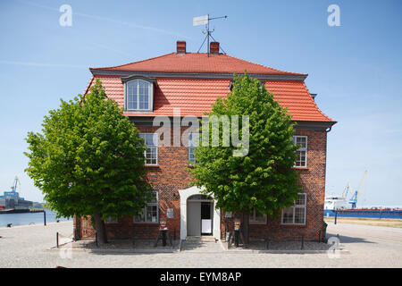 Germany, Mecklenburg-Western Pomerania, Wismar, old harbour and historical 'Baumhaus' - Stock Photo