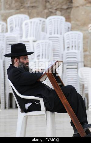 Old Town of Jerusalem, religious orthodox Jew on the Wailing Wall (Hakotel), Israel - Stock Photo