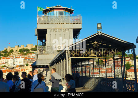 Lisbon, Tourist at Santa Justa elevator and St. George«s Castle at background, Elevador de Santa Justa, Castelo - Stock Photo