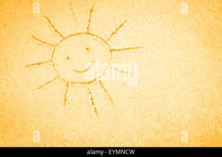 sun shape drawing on sand - Stock Photo