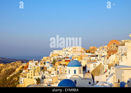 The beautiful village Oia on Santorini island in the early morning hours - Stock Photo