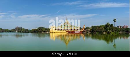 Panorama of Karaweik - replica of a Burmese royal barge and Kandawgyi Lake, Yangon, Myanmar Burma - Stock Photo