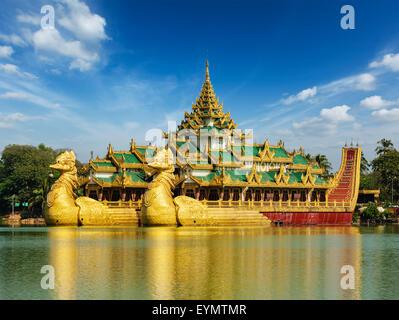 Yangon icon landmark and tourist attraction Karaweik - replica of a Burmese royal barge at Kandawgyi Lake, Yangon, - Stock Photo