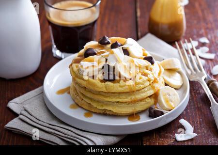 Waffles with banana slices, caramel and chocolate - Stock Photo