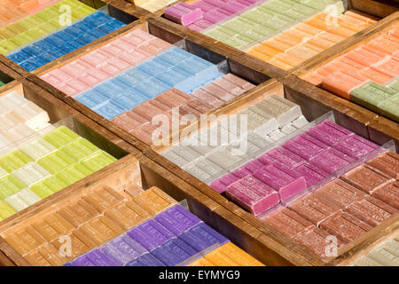 Assortment of bars of soap for sale on the market - Stock Photo