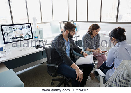 Architects, with digital tablet meeting in office - Stock Photo