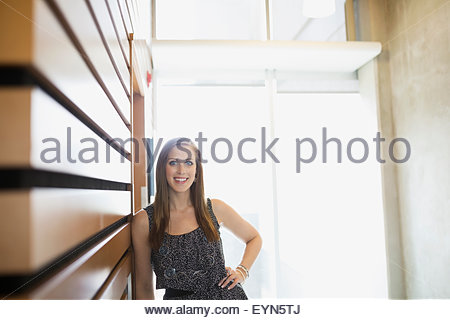 Portrait confident woman leaning on wall - Stock Photo