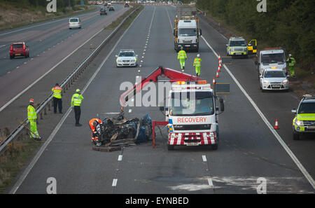 Emergency services attend a traffic accident that completely closed the southbound carriageway of the M5 on Saturday - Stock Photo