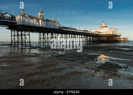 Eastbourne Pier as viewed from the shoreline at low tide. East Sussex, England, UK. - Stock Photo