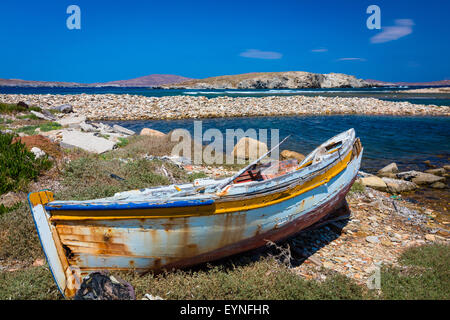 Dilapidated Greek boat in the Aegean Sea on the island of Delos - Stock Photo