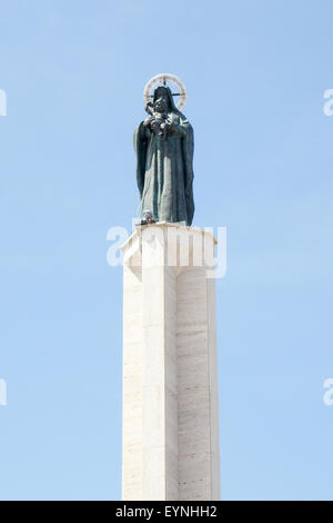 Statue of the Virgin Mary and Child on a column. - Stock Photo