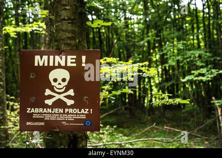 Minefield warning sign, Grabez, Bosnia and Erzegovina - Stock Photo
