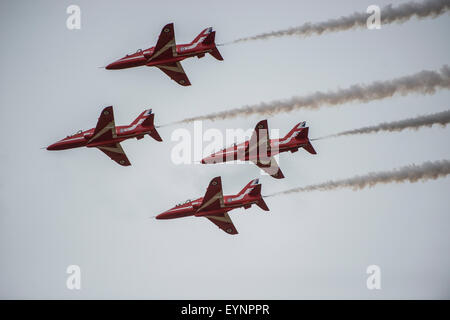The Red Arrows, aerobatic display team performing in the skies above the Fairford International Air Tattoo - Stock Photo