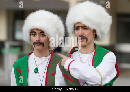 Stockton-on-Tees, UK, Saturday, 1st August, 2015. Two comedy female street performers dressed as men, in fancy dress - Stock Photo