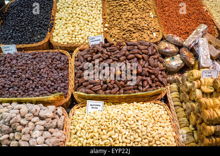 Different kinds of nuts and dry fruits at the Boqueria market in Barcelona - Stock Photo