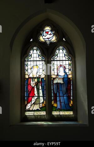 Stained glass window in All Saints Church, Hovingham, North Yorkshire - Stock Photo