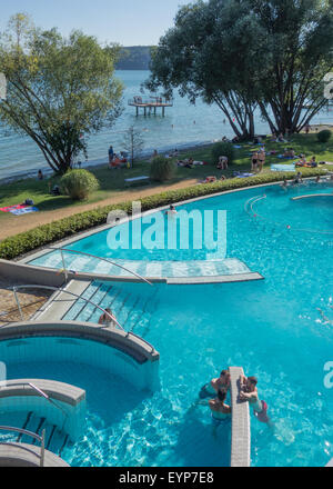 hot springs at Bodensee-Therme, Uberlingen, Germany, with the beach and Lake Constance beyond - Stock Photo