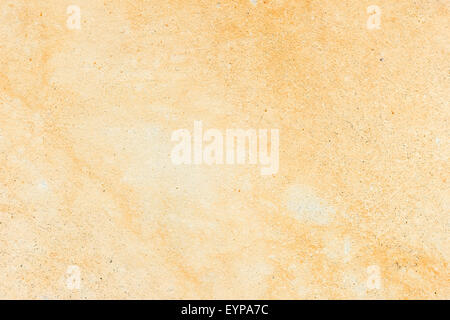Pale Orange Paint worn pale yellow wall background, paint partly faded stock photo
