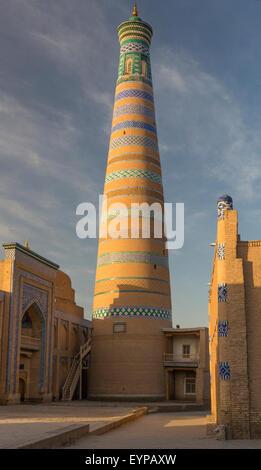 Isom-Hoja Minaret and Medressa in the fabled Silk Road city of Khiva, Uzbekistan - Stock Photo