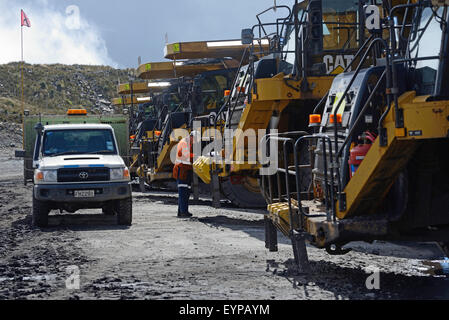 WESTPORT, NEW ZEALAND, MARCH 11, 2015: A mechanic cheks the 70 ton tip trucks at Stockton open cast coal mine - Stock Photo