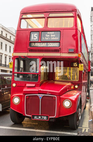 Classic Routemaster red double-decker bus at a stop on the Strand, London - Stock Photo