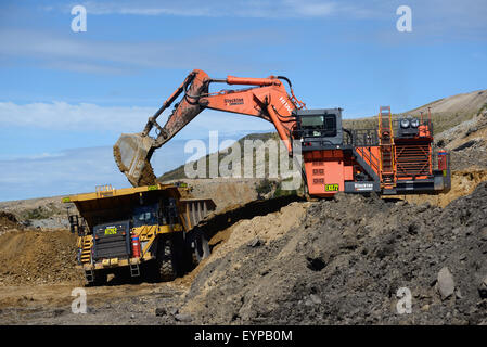 WESTPORT, NEW ZEALAND, MARCH 11, 2015: 190 ton digger loads rock from a layer of overburden at Stockton open cast - Stock Photo