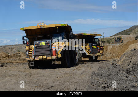 WESTPORT, NEW ZEALAND, MARCH 11, 2015: 130 ton loads of rock overburden are carried away at the Stockton open cast - Stock Photo