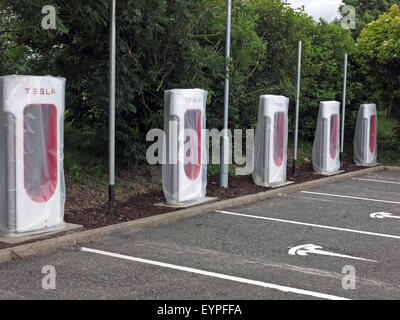 Tesla charging points being implemented on a motorway service area in the UK - Stock Photo