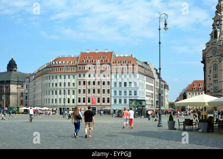 Tourists on the New Market n Dresden before the townhouses. - Stock Photo