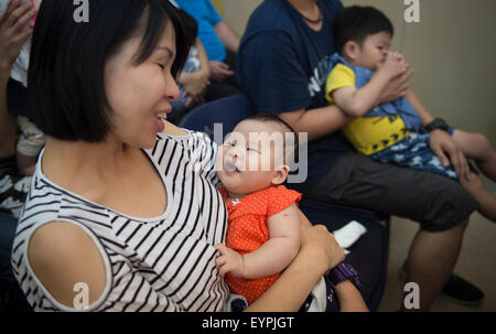 Hong Kong, China. 2nd Aug, 2015. Mothers and babies take part in an event to mark the World Breastfeeding Week 2015 - Stock Photo