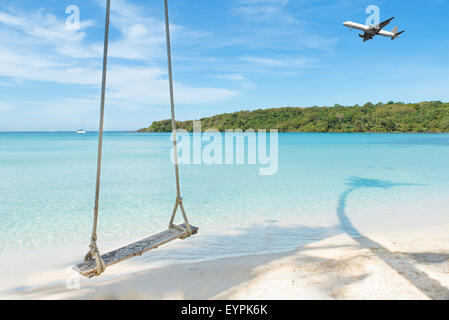 Summer, Travel, Vacation and Holiday concept - Airplane arriving tropical beach sea in Phuket ,Thailand. - Stock Photo