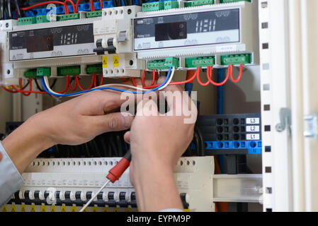 electrician wiring up a switchboard in a new building stock photo rh alamy com wiring up a switchboard australia