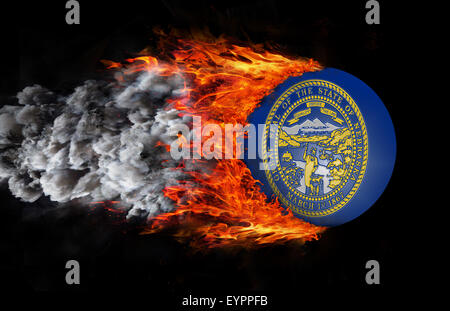 Concept of speed - Flag with a trail of fire and smoke - Nebraska - Stock Photo