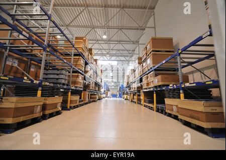 Inside a modern car factory, vehicles and parts move through the production process - Stock Photo