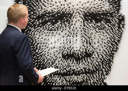 London, UK. 3 August 2015. Barack Obama portrait 'Shoot to Kill' by Joe Black, made of 11,000 toy soldiers. On 10 - Stock Photo