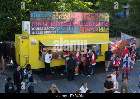 Food stall outside Wembley Park Station after a football match - Stock Photo