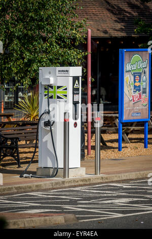 Electric charging point for vehicles in a car park in England. - Stock Photo