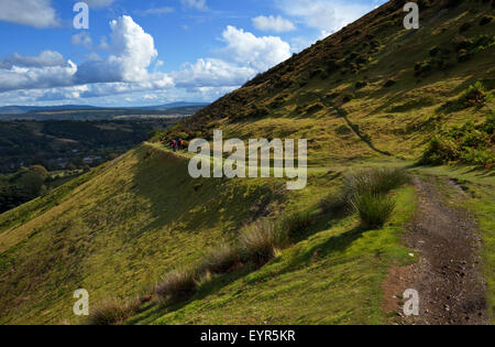 Hikers on the track along the side of Callow Mountain,  Above Little Stretton, Shropshire, England, UK - Stock Photo