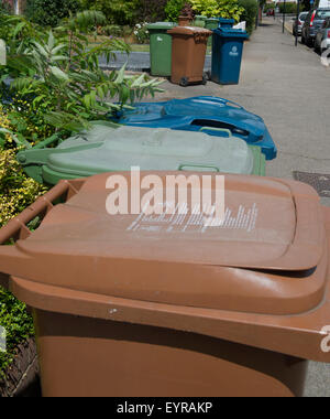 Domestic refuse wheeley bins in front gardens - Stock Photo