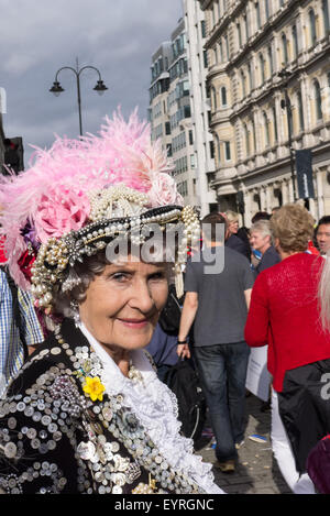 Trafalgar Square, London, Engand. A smiling 'Pearly Queen' in the crowds. - Stock Photo