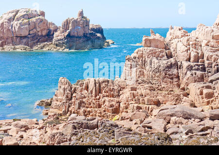 Coast with famous pink granite rocks in Brittany, France - Stock Photo